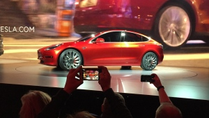 Tesla Motors unveils the new lower-priced Model 3 sedan at the Tesla Motors design studio in Hawthorne, Calif., Thursday, March 31, 2016. (AP Photo / Justin Pritchard)
