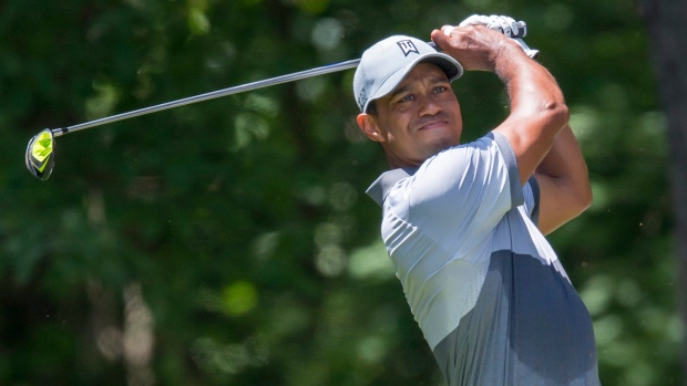 In this Saturday, Aug. 22, 2015 file photo, Tiger Woods tees off on the second hole during the third round of the Wyndham Championship golf tournament at Sedgefield Country Club in Greensboro, N.C. (AP Photo / Rob Brown, File)