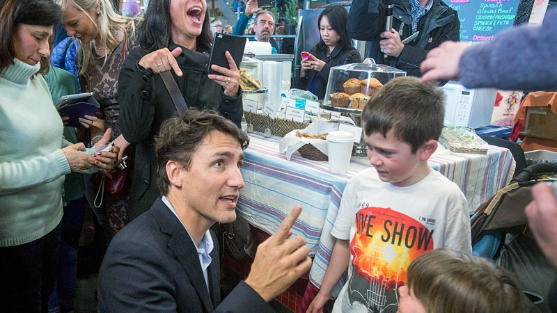 Prime Minister Justin Trudeau talks with children as he visits the Seaport Farmers' Market in Halifax on Saturday, April 2, 2016. (THE CANADIAN PRESS/Andrew Vaughan)