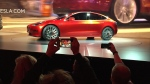 Tesla Motors unveils the new lower-priced Model 3 sedan at the Tesla Motors design studio in Hawthorne, Calif., Thursday, March 31, 2016. It doesn't go on sale until late 2017, but in the first 24 hours that order banks were open, Tesla said it had more than 115,000 reservations. Long lines at Tesla stores, reminiscent of the crowds at Apple stores for early models of the iPhone, were reported from Hong Kong to Austin, Texas, to Washington, D.C. Buyers put down a $1,000 deposit to reserve the car. (Justin Pritchard / AP)