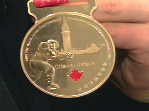 One of the Canada's junior hockey team members shows off his gold medal on Tuesday, Jan. 6, 2009