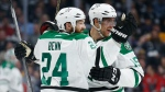 Dallas Stars defenseman Jordie Benn, left, celebrates his goal with teammate defenseman Patrik Nemeth, right, during the third period of an NHL hockey game against the Los Angeles Kings, Saturday, April 2, 2016, in Los Angeles. (AP / Danny Moloshok)