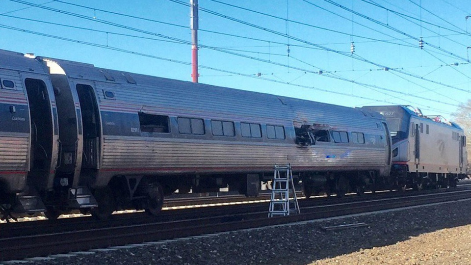 This photo shows an Amtrak train following an accident Sunday, April 3, 2016, in Chester, Pa. Amtrak said the train was heading from New York to Savannah, Ga., when it struck a backhoe outside of Philadelphia. (Glenn R. Hills Jr via AP)