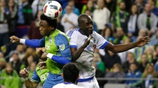 Seattle Sounders forward Oalex Anderson, left, goes for a header against Montreal Impact's Hassoun Camara during the second half of an MLS soccer match, Saturday, April 2, 2016, in Seattle. (AP Photo/Ted S. Warren)