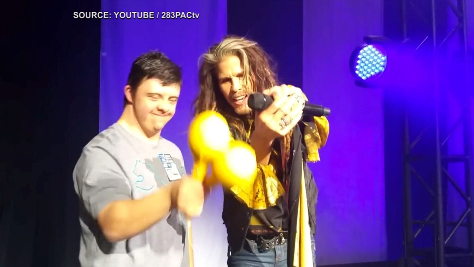 Anthony Yorfido performs on stage with Aerosmith singer Steven Tyler.