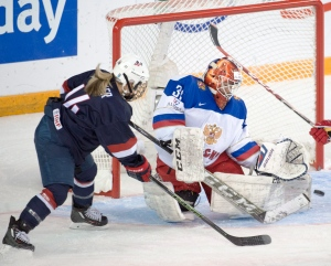 The United States' Brianna Decker (14) is stopped by Russia's goalie Anna Prugova during first period semifinal action at the women's world hockey championships in Kamloops, B.C., on Sunday, April 3, 2016. (Ryan Remiorz / THE CANADIAN PRESS)