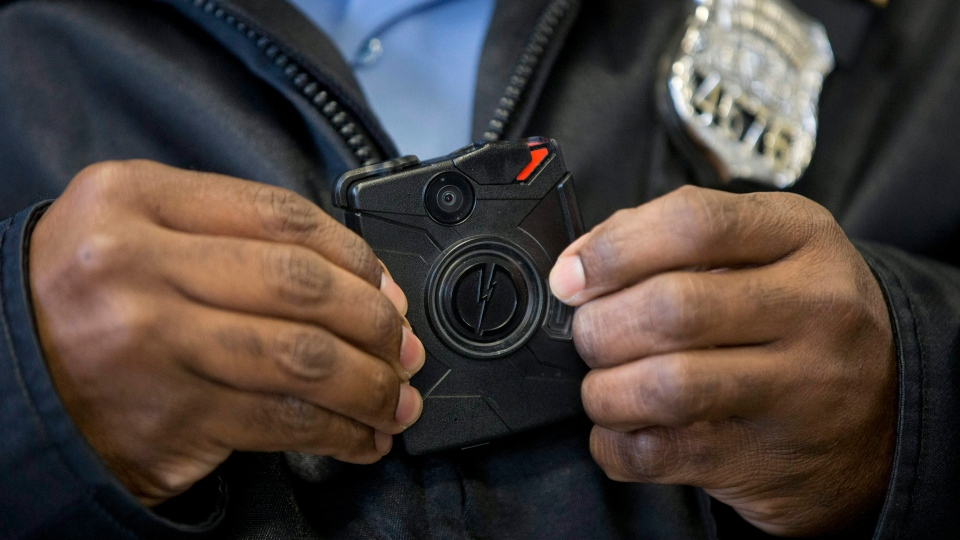 In this Dec. 11, 2014, file photo, a Philadelphia Police officer demonstrates a body-worn camera being used as part of a Philadelphia Police pilot project in the department's 22nd District, in Philadelphia. (AP Photo/Matt Rourke)
