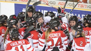 Team Canada celebrates after defeating Finland 5-3 in semi-final action at the women's world hockey championships in Kamloops, B.C., Sunday, April 3, 2016. (THE CANADIAN PRESS/Ryan Remiorz)