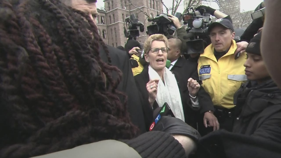 Premier Kathleen Wynne speaks to protesters with the Black Lives Matter movement outside Queen's Park on April 4, 2016.
