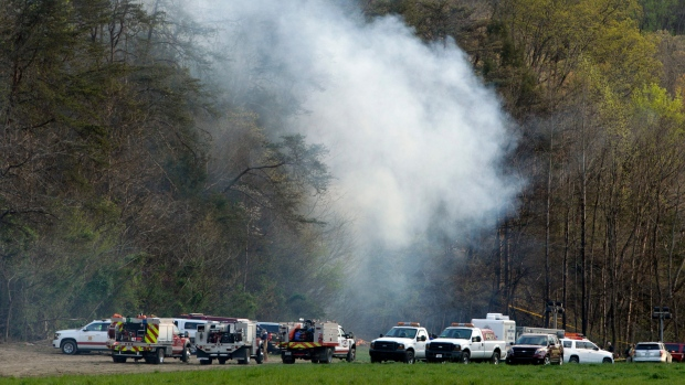 Emergency personnel work where a sightseeing helicopter crashed near Sevierville, Tenn., on Monday, April 4, 2016. (AP Photo/Wade Payne)