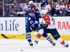 Florida Panthers centre Rocco Grimaldi (23) fights off Toronto Maple Leafs right wing Kasperi Kapanen (37) during first period NHL hockey action in Toronto on April 4, 2016. (Nathan Denette / The Canadian Press)