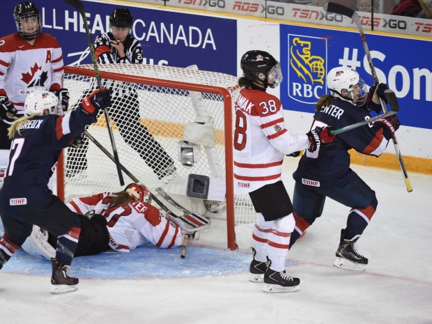 United States's Alex Carpenter celebrates her overtime goal against Canada in gold medal action at the women's world hockey championships Monday, April 4, 2016 in Kamloops, B.C. (Ryan Remiorz / THE CANADIAN PRESS)
