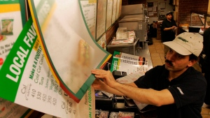 Amin Chakma puts up new menus featuring calorie counts at a Subway restaurant in New York in this June 29, 2007, file photo. (AP Photo/Dima Gavrysh)