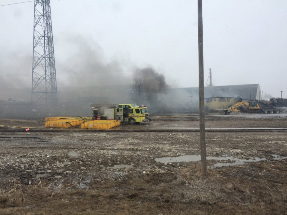 Smoke billows from a fire at Shercom Industries north of Saskatoon on Tuesday. Fire crews were called to the blaze Monday evening. (Twitter/@SaskatoonFire)