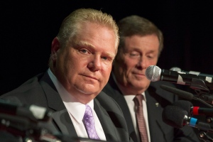Doug Ford (left) sits alongside John Tory as he takes part in a Toronto Mayoral Debate, in Toronto on September 23, 2014. (Chris Young / The Canadian Press)