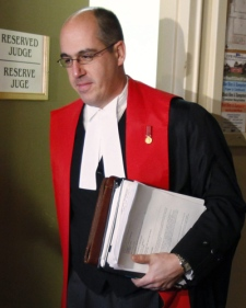 Judge Lt.-Col. Louis-Vincent d'Auteuil leaves his quarters for the second day of hearings in the case of Captain Robert Semrau case at CFB Petawawa, Ont., on Wednesday Jan. 7, 2009. (Tom Hanson / THE CANADIAN PRESS)