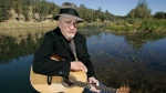 In this Oct. 2, 2007 file photo, Merle Haggard poses at his ranch at Palo Cedro, Calif. (AP Photo/Rich Pedroncelli)