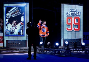 Former player Wayne Gretzky waves to the crowd during the Edmonton Oilers farewell ceremony at Rexall Place in Edmonton, Alta., on Wednesday April 6, 2016. (Jason Franson / THE CANADIAN PRESS)