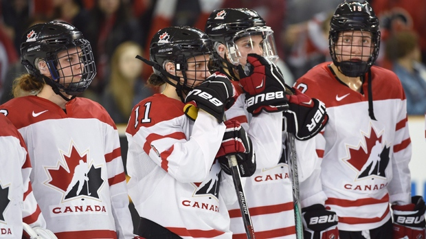 Dejected Canadian players watch the United States celebrate their 1-0 victory in overtime gold medal action at the women's world hockey championships Monday, April 4, 2016 in Kamloops, B.C. THE CANADIAN PRESS/Ryan Remiorz
