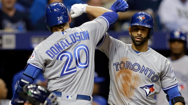 Toronto Blue Jays' Josh Donaldson (20) celebrates with on-deck batter Jose Bautista after hitting a home run off Tampa Bay Rays starting pitcher Drew Smyly during the fifth inning of a baseball game Monday, April 4, 2016, in St. Petersburg, Fla. (Chris O'Meara /AP Photo)