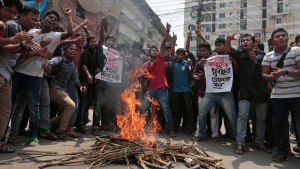 Bangladeshi students protest over seeking the arrest of three motorcycle-riding assailants who hacked student activist and blogger Nazimuddin Samad to death as he walked with a friend, in Dhaka, Bangladesh in this photo taken on April 7, 2016. (AP)