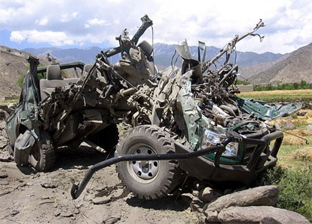 A damaged police vehicle is seen after it was hit by a roadside bomb in Dara-I-Nur district of Nangarhar province, east of Kabul, Afghanistan on Monday, May 21, 2007. (AP / Rahmat Gul)