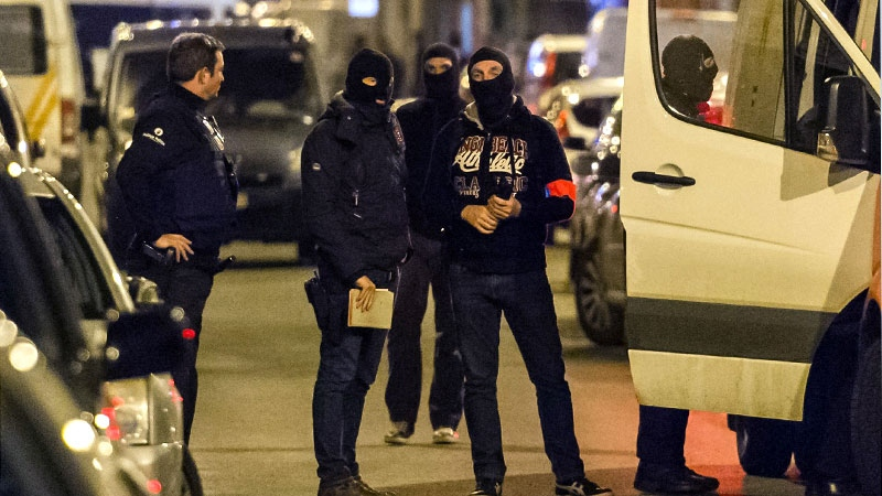 Police investigate an area where terror suspect Mohamed Abrini was arrested earlier today, in Brussels on Friday April 8, 2016.  (AP /Geert Vanden Wijngaert)