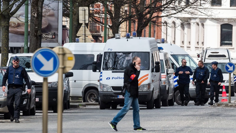 Police secure an area during a house search in the Etterbeek neighborhood in Brussels on Saturday April 9, 2016.  (AP /Geert Vanden Wijngaert)