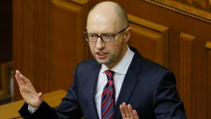 In this Tuesday, Feb. 16, 2016 file photo Ukrainian Prime Minister Arseniy Yatsenyuk speaks during an annual report in Parliament in Kiev, Ukraine. Ukraine's embattled Prime Minister Arseniy Yatsenyuk says he is resigning, opening the way for the formation of a new government to end a drawn-out political crisis. (AP Photo / Sergei Chuzavkov, file)