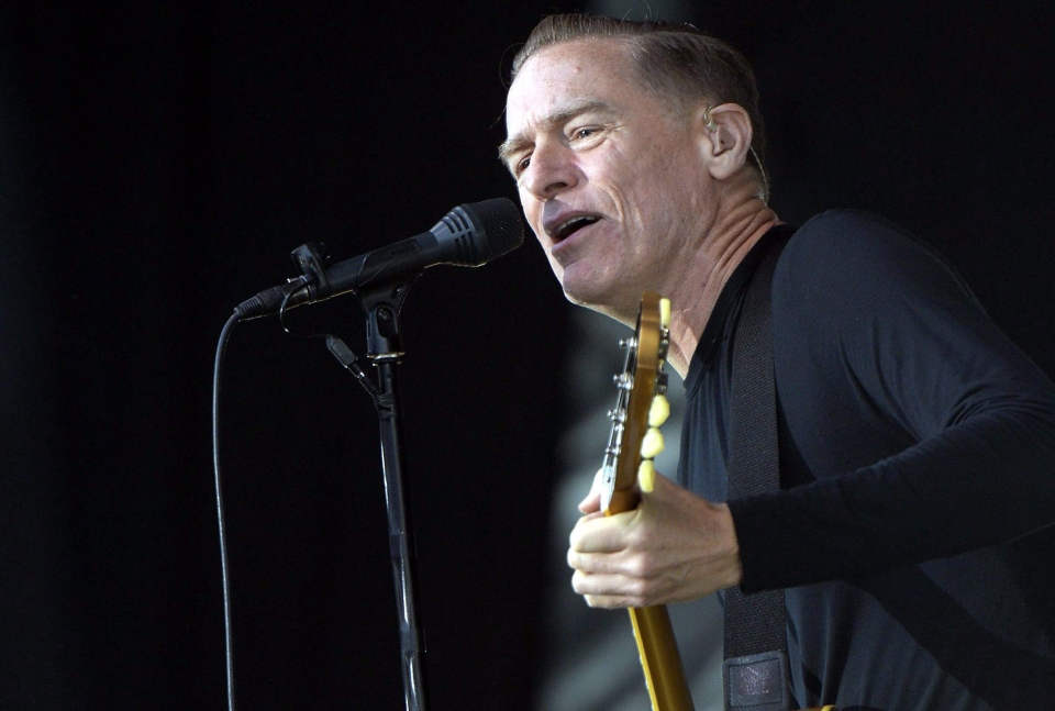 In this picture made available Friday July 12, 2013 Canadian singer Bryan Adams performs on stage at the 'Live at Sunset Festival