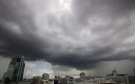 Dark clouds gather above the skyline in Bangkok, Thailand, Thursday, Sept. 24, 2015. (AP Photo/Sakchai Lalit)