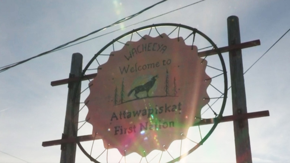 A sign welcomes visitors to the remote northern Ontario community of Attawapiskat.