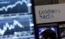 In this Oct. 16, 2014, file photo, a screen at a trading post on the floor of the New York Stock Exchange is juxtaposed with the Goldman Sachs booth.  (THE CANADIAN PRESS / Richard Drew)