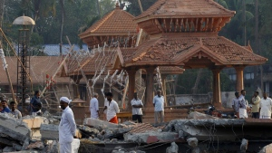 People check out the damaged structures after a massive fire broke out Sunday during a fireworks display at the Puttingal temple complex in Paravoor village, Kollam district, southern Kerala state, India, Monday, April 11, 2016. (AP / Aijaz Rahi)