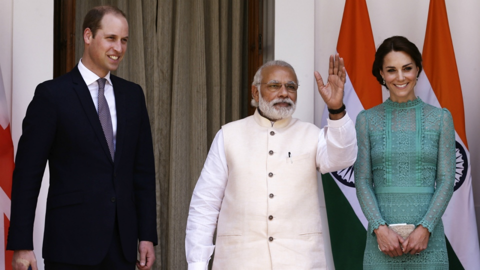 Prince William, left, and his wife Kate, the Duchess of Cambridge, right, are greeted by Indian Prime Minister Narendra Modi as they arrive for a lunch with him, in New Delhi, India, Tuesday, April 12, 2016. (AP / Saurabh Das)