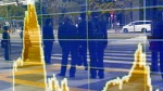 In this April 8, 2016 file photo, people are reflected on the electronic board of a securities firm in Tokyo. (AP Photo/Shizuo Kambayashi)