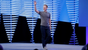 Facebook CEO Mark Zuckerberg waves walking on stage to deliver the keynote address at the F8 Facebook Developer Conference Tuesday, April 12, 2016, in San Francisco. (AP Photo/Eric Risberg)