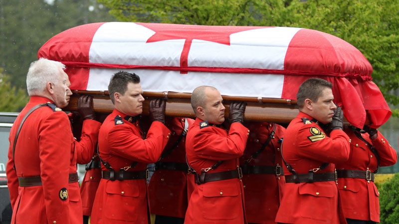 RCMP pallbearers carry the casket of Const.Sarah Beckett during a regimental funeral service at the Q Centre arena in Colwood, B.C. on April 12, 2016. (THE CANADIAN PRESS/Chad Hipolito)