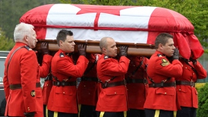 RCMP pallbearers carry the casket of Const. Sarah Beckett during a regimental funeral service at the Q Centre arena in Colwood, B.C., Tuesday, April 12, 2016. (Chad Hipolito / THE CANADIAN PRESS)