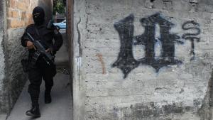 A masked and armed policeman patrols a gang controlled neighbourhood in San Salvador, El Salvador on April 5, 2016. (AP / Alex Pena)
