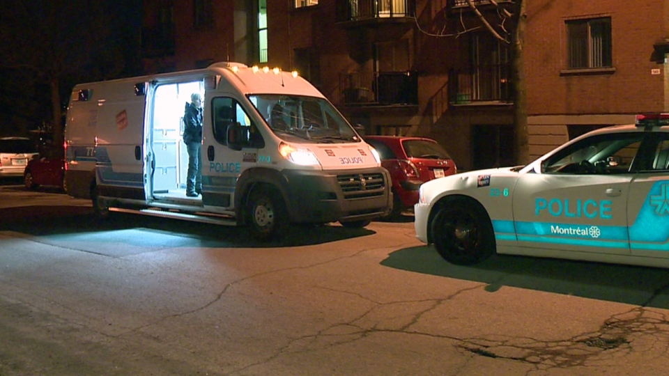 Montreal police in a van parked outside a Davidson St. apartment building where the suspect in the murder of Clemence Beaulieu-Patry was located (Cosmo Santamaria/CTV Montreal)