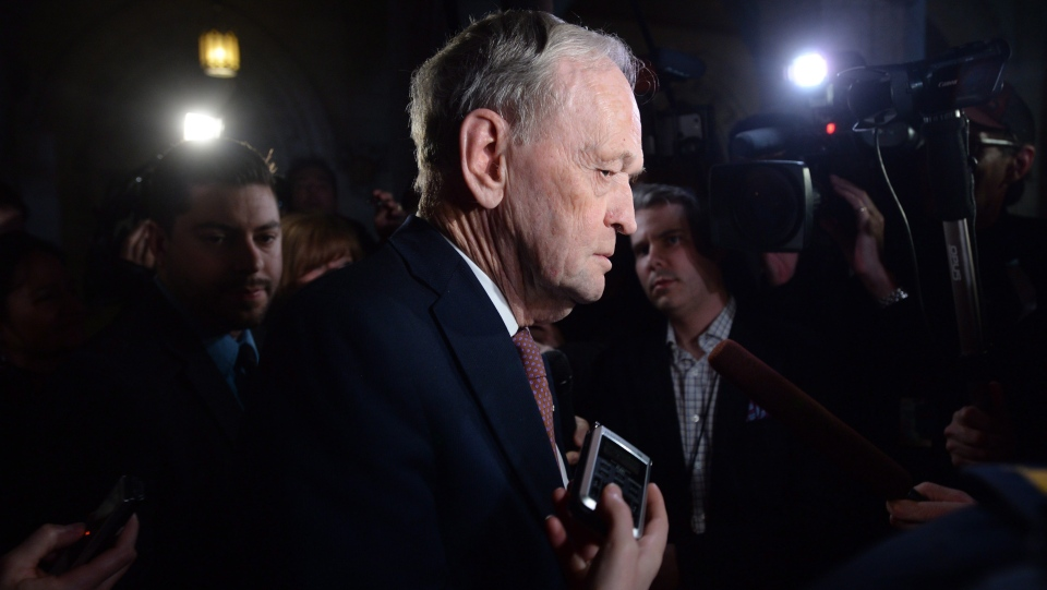Former prime minister Jean Chretien leaves the swearing-in ceremony for seven new senators on Parliament Hill in Ottawa, Tuesday April 12, 2016. (Adrian Wyld/ THE CANADIAN PRESS)