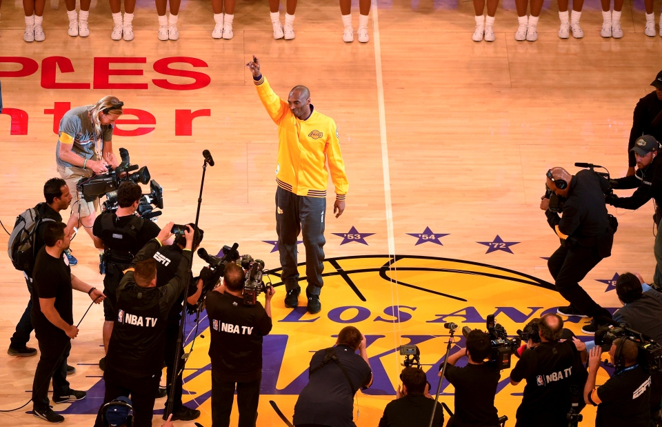 f705a42c923 Los Angeles Lakers forward Kobe Bryant waves to the crowd during a ceremony  before Bryant s last NBA basketball game