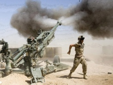 Gunner Jody Winsor, from Robert's Arm, N.L., with the Canadian 2nd Royal Canadian Horse Artillery (RCHA) fires a 155 mm howitzer in support of front line troops during a mission at the forward operating base in Helmand Province, Afghanistan on Wednesday, April 18, 2007. (THE CANADIAN PRESS / Ryan Remiorz)