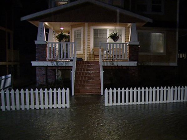 Rising floodwaters hit the front steps of a home in B.C.'s Fraser Valley on January 9, 2009.