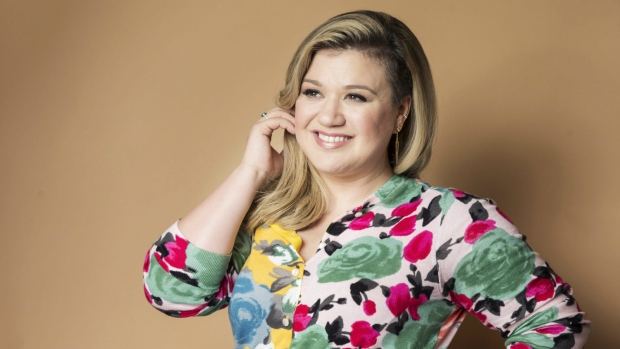 American singer and songwriter Kelly Clarkson poses for a portrait to promote her album 'Piece by Piece' in New York on March 4, 2015. (Invision / Victoria Will)