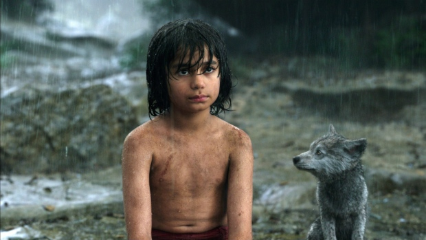 Mowgli, portrayed by Neel Sethi, left, and Gray, voiced by Brighton Rose, appear in a scene from, 'The Jungle Book.' (Disney )