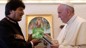 Bolivia's President Evo Morales, left, presents Pope Francis with books on the occasion of their private meeting in the Apostolic Palace at the Vatican, Friday, April 15, 2016. (AP / Alessandra Tarantino, pool)