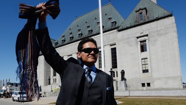 Gabriel Daniels, son of the late Harry Daniels, reacts as he leaves the Supreme Court of Canada following their unanimously ruling that Metis and non-status are Indians under the Constitution, in Ottawa, on Thursday, April 14, 2016. (Sean Kilpatrick / THE CANADIAN PRESS)