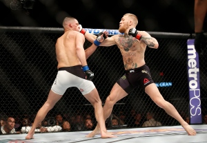 Nate Diaz, left, trades punches with Conor McGregor during their UFC 196 welterweight mixed martial arts match in Las Vegas, Saturday, March 5, 2016. (AP / Eric Jamison)